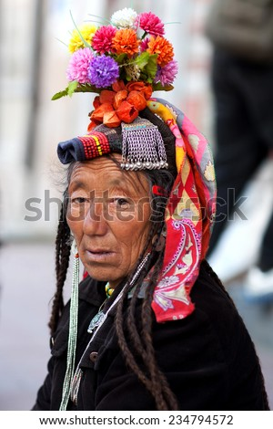 LEH, INDIA - JUNE 14: An unidentified Drokpa woman in national clothes poses for a photo during Yuru Kabgyat festival on June 14, 2012 in Lamayuru, North India. - stock photo