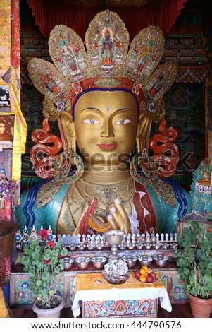 Leh, India - June 24, 2016: Image of Lord Buddha in Thiksay Tibetan Buddhist monastery, located on top of a hill in Thiksey village, near Leh in Ladakh, India. Visitors reguraly come to pray here. - stock photo