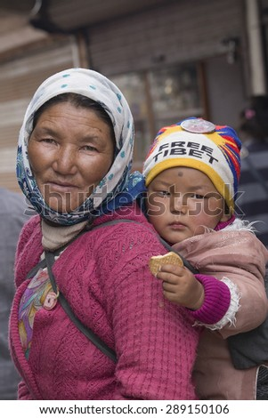 LEH, INDIA - JUNE 21, 2015: Unidentified local woman with the child, outdoor in Ladakh. The majority of the local population are descendant of Tibetan.