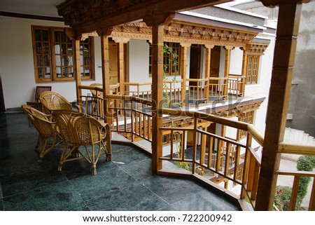 LEH, INDIA - SEP 11, 2017 -  Comfortable chairs on veranda of the cases were Grand Willow Hotel, Leh, Ladakh, India