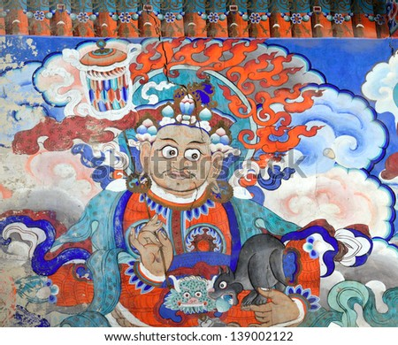 LEH, LADAKH, INDIA - SEPTEMBER 13, 2012:  Old buddhist fresco at the wall of tibetan monastery Hemis Gompa, Leh, India. September 13, 2012.