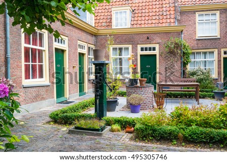 LEIDEN, NETHERLANDS - AUG 9, 2016: Patio of Michielshofje with almshouses in old town of Leiden, South Holland, Netherlands