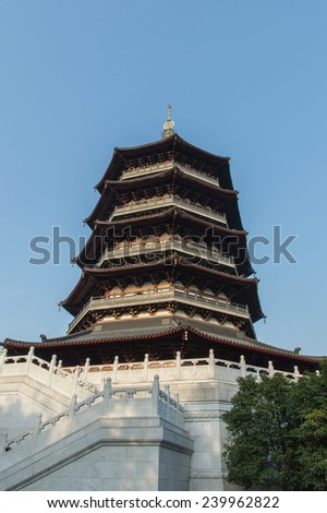 Leifeng Pagoda , on the idyllic West Lake in Hangzhou. Originally constructed in the year AD 975, it was rebuilt in 2002, since then it has been a popular tourist attraction. Zhejiang, China