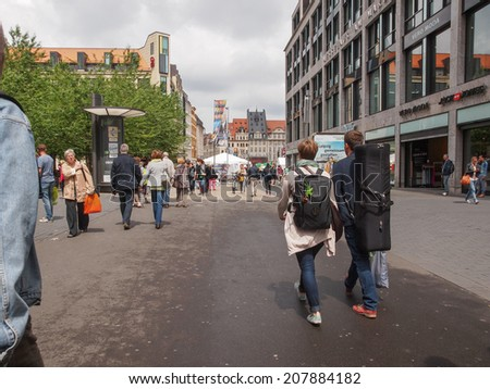 LEIPZIG, GERMANY - JUNE 14, 2014: Tourists visiting the city centre in summer