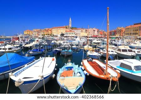 Leisure and fishing boats inside the harbor of Venetian town of Rovinj, Croatia - stock photo