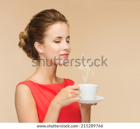 leisure, happiness and drink concept - smiling woman in red dress with cup of coffee - stock photo
