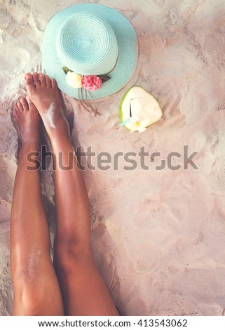 Leisure in summer - Beautiful of sexy women tan. relax on sandy beach with hat and coconut cocktail. vintage color styles - stock photo