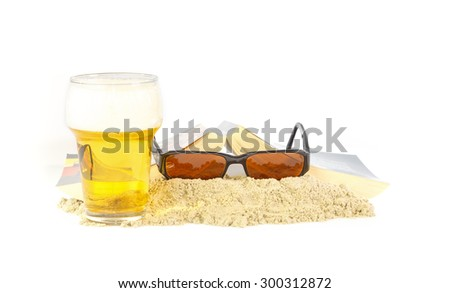 Leisure time on the beach with a good book and a beer - stock photo