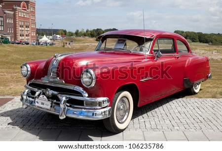 LELYSTAD, THE NETHERLANDS - JUNE 17: A 1953 Pontiac Chieftain on display at the annual National Oldtimer day on June 17, 2012 in Lelystad, The Netherlands - stock photo
