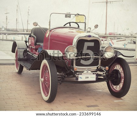 LELYSTAD, THE NETHERLANDS - JUNE 17, 2012: 1929 Ford A Speedster on display at the annual National Oldtimer day. Textured filtered image in a nostalgic retro look.  - stock photo