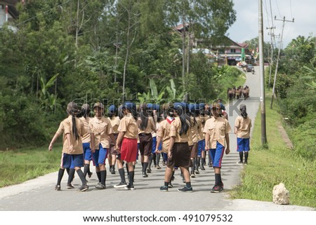 Lemo, North Toraja, Indonesia-Aug 27, 2016:School children with special uniform practice and parade at the road for yearly sport event preparation in Lemo, North Toraja, Indonesia.