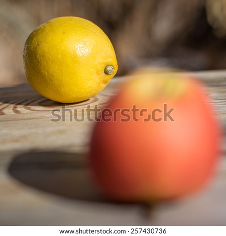 lemon and apple on wooden table