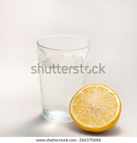 Lemon and glass of water - stock photo