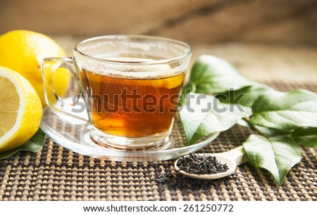 Lemon and Green Tea in Transparent Cup, Fresh Healthy Detox Tea - stock photo