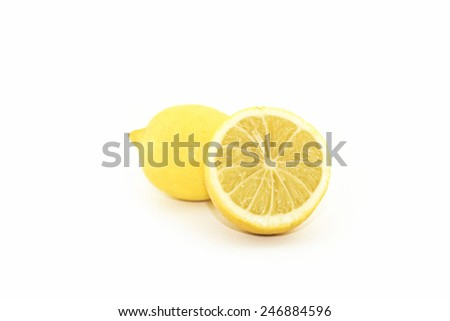 lemon and its half with reflection isolated on white - stock photo