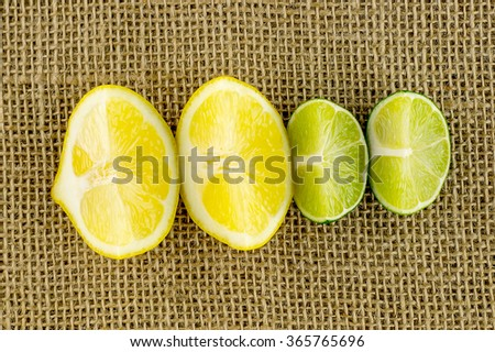 Lemon and lime wedges ready to be squeezed - stock photo