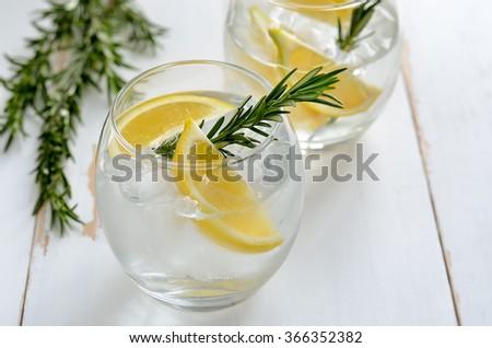 Lemon and rosemary refreshing alcoholic drink, soda or fizz  - stock photo