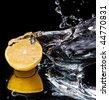 Lemon and splash water over black background - stock photo