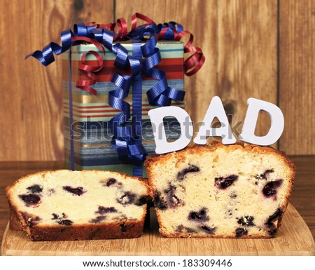 Lemon blueberry poundcake and a gift for dad on his special day. - stock photo