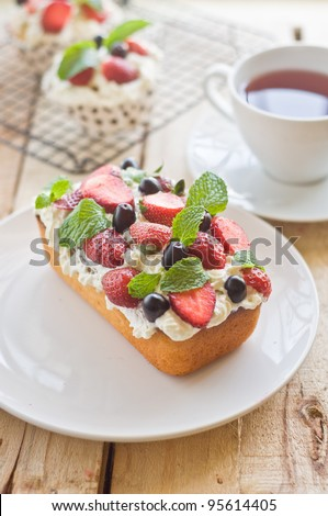 Lemon Cake topped with whipped cream, fresh fruits and mint 4 - stock photo
