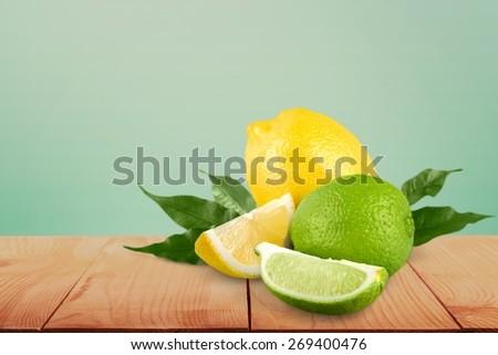 Lemon. Collection of fresh limes and lemons - collage - stock photo
