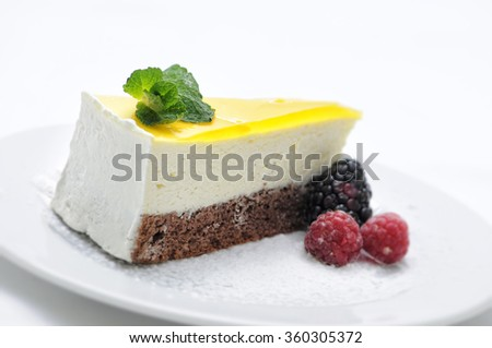 lemon cream cake with fruit and gelatin on white plate, sweet dessert, product photography for patisserie or shop - stock photo