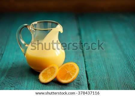Lemon curd in glass jar with fresh lemons on green background copyspace - stock photo