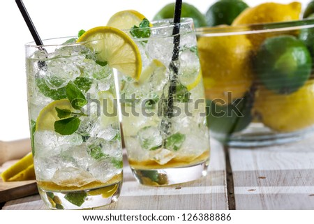 Lemon drink with ice in glass
