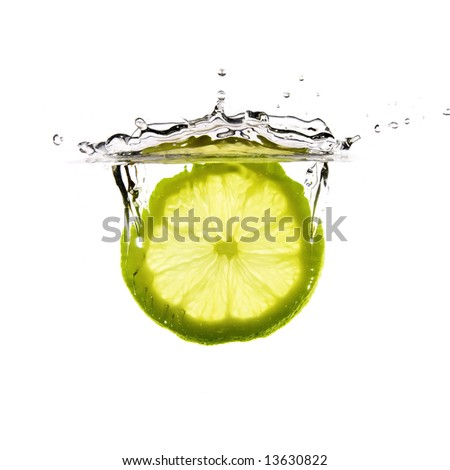 lemon falls into water - stock photo