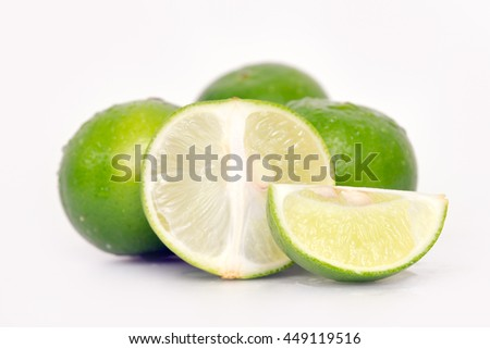 Lemon fruit (Also known as lime in French, citrus fruit, lime green, Key lime, Persian lime, Kaffir lime, desert lime) with half cross section and partial section isolated on white - stock photo