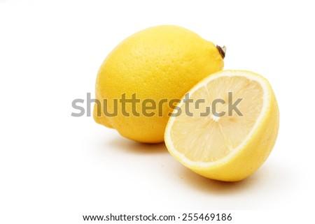 Lemon fruit with sliced lemon - stock photo