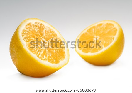 lemon halves on grey background - stock photo