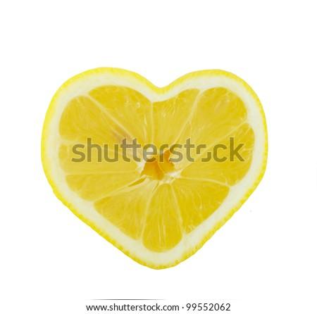 Lemon heart shaped slice cross section isolated on white background - stock photo