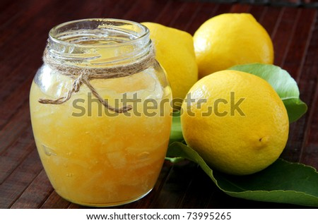 Lemon homemade jam on wooden background - stock photo