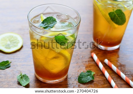 Lemon iced tea with mint, selective focus - stock photo