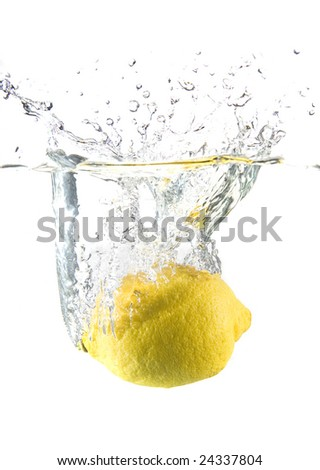 Lemon in water with bubbles on white ground