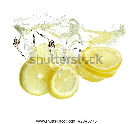 Lemon is dropped into water. isolated on white background