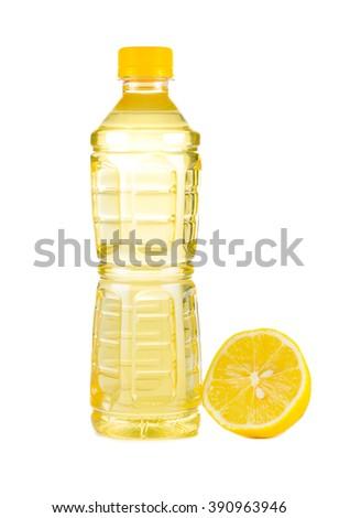 Lemon juice  bottle, ripe limes Isolated on white background - stock photo