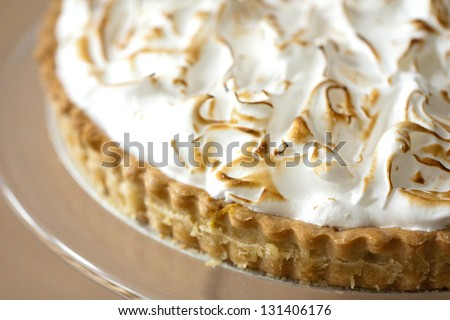 Lemon Meringue Pie on Serving Dish close up - stock photo