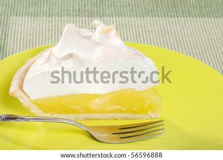 lemon meringue pie slice on plate - stock photo
