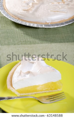 lemon meringue pie with fork - stock photo