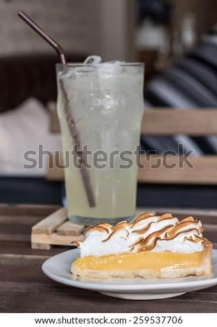 Lemon meringue pie  with lemon juice - stock photo