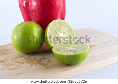 Lemon on a wooden cutting board