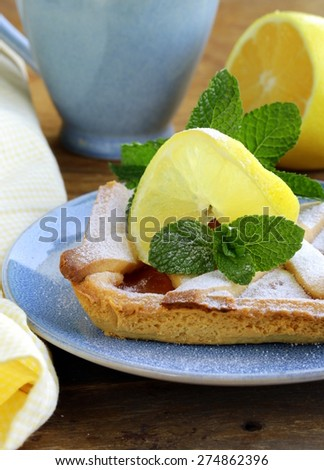 lemon pie with mint leaves and powdered sugar - stock photo