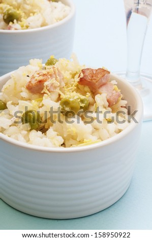 lemon rice with bacon and peas in a cup