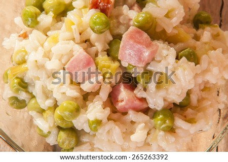 lemon risotto with bacon and peas - stock photo