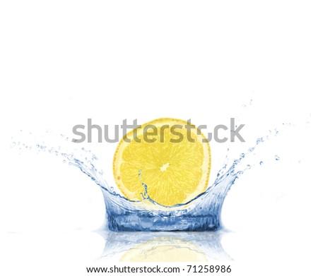 Lemon slice dropped into water, isolated on white background - stock photo