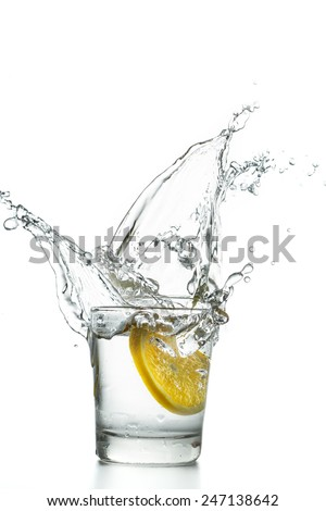 Lemon slice splashing into Water - stock photo
