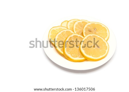 Lemon sliced on a plate on a white background - stock photo