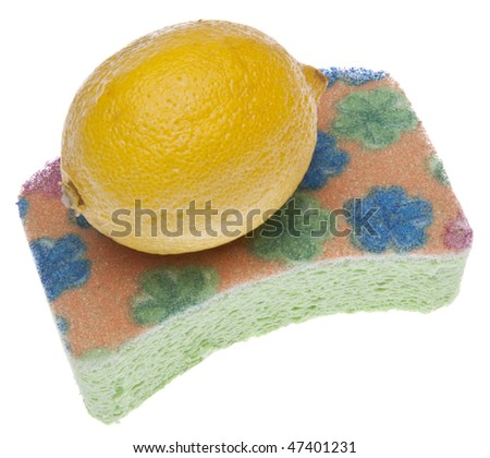 Lemon slices and a sponge for the annual event of spring cleaning.  Isolated on white with a clipping path.